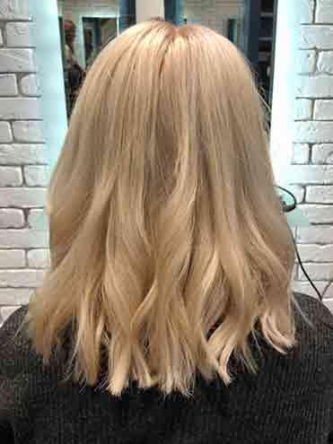 Woman in salon hair cut